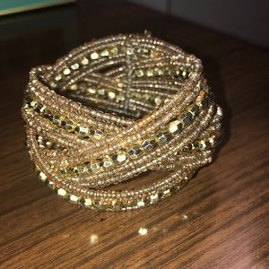 Wrap around gold beaded bracelet